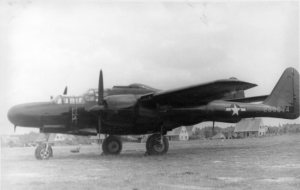 A 425th Night Fighter Squadron Northrop P-61B-15-NO Black Widow serial number 42-39674 rests at R-30, Fürth/Industriehafen Airfield, circa the spring/summer of 1945.  According to Joe Baugher's serial number website, this aircraft was condemned to salvage on April 23, 1947.  Note the unidentified German aircraft (Henschel Hs-126?) in the background just behind the P-61's right landing gear.  (Courtesy Ms. Nancy Beaumier, daughter of 371FG veteran Tom Boliaris)