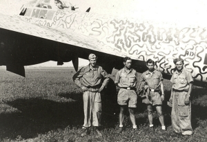 "Three of the four man crew of one of the German bombers belonging to the 4th Staffel of KG30, which was shot down on the night of 23 April 2014 near Hill Deverill.  Left to right are Pilot, Unteroffizier. Rudolf Detering (POW);  Gunner, Unteroffizier  Helmut Trauwald (Killed in Action); Observer, Unteroffizier Johann Agten (POW) and Radio/Op, Unteroffizier Ruell (Uffz Walter Kempter 's (POW) predecessor).  The aircraft is a Junkers Ju 88 similar to the version they the night of their fatal mission flew (Ju 88A-14).  It is painted in the ""Wellenmuster"" wave pattern camouflage.  (Aircrew Remembrance Society)"